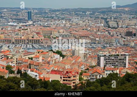 View from Notre-Dame de la Garde over the city with marina, Marseille, Bouches-du-Rhône department - Stock Photo
