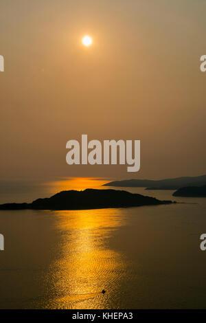Sunset over Sveti Stefan Island, coast near Budva, Montenegro - Stock Photo