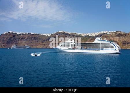 Cruise ship at Thira, Santorin island, Cyclades, Aegean, Greece - Stock Photo