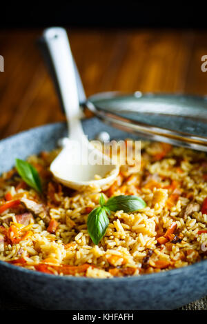 Pilaf with beef, carrots, onions, garlic, pepper and cumin. A traditional dish of Asian cuisine. - Stock Photo