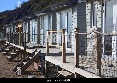 Wooden, Seafront Beach Huts, Lyme Regis, Dorset, UK - John Gollop - Stock Photo