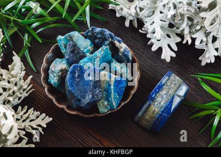 Stones of the Throat Chakra on Dark Table - Stock Photo