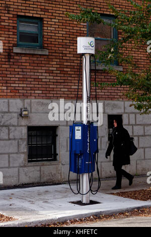 An electric car charge point in a sreet in Montreal - Stock Photo