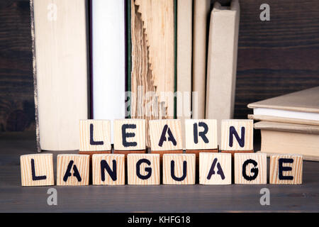 learn language, wooden letters on wooden table. Education, success and communication background - Stock Photo