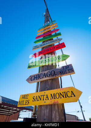 Direction signs to famous cities at Route 66 - Stock Photo