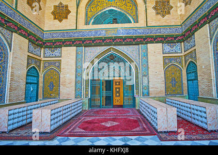 TEHRAN, IRAN - OCTOBER 11, 2017: The main entrance of Shah's Mosque with tiled patterns on the brick wall, on October - Stock Photo