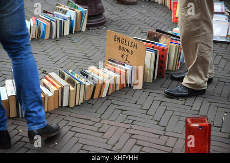 TBook stall on the popular, bustling Waterlooplein flea market, in Amsterdam, in the Netherlands, North Europe - Stock Photo