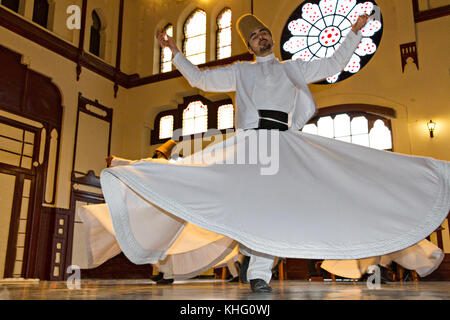 Whirling dervish during sufi whirling ritual known as Sema, in Istanbul, Turkey - Stock Photo