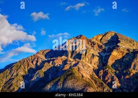 Morning sunrise casts a golden glow on the top of Pyramid Mountain in Jasper National Park in Alberta, Canada Stock Photo