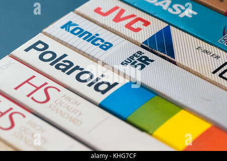 NOVI SAD, SERBIA - NOVEMBER 6, 2017: Various brands of VHS video cassettes wrappers. Video Home System, analog video - Stock Photo