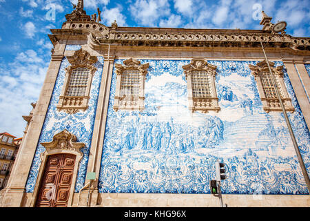 Facade view on the church wall with famous poruguese blue tiles Azulejo in Porto city in Portugal - Stock Photo