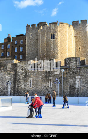 Tower of London, UK. 17th Nov, 2017. People enjoy the first ice skating session of the season at the Tower of London - Stock Photo