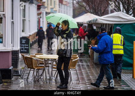 Aberystwyth  Wales UK, Saturday 18 Novemberr 2017  UK Weather: People walking under their umbrellas at the Farmers - Stock Photo