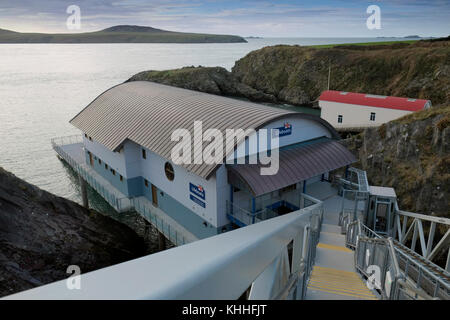 The new St.Davids (Wales, UK) Lifeboat Station in the foreground with the old one in the background. - Stock Photo