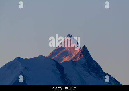 top of Weisshorn mountain in Switzerland in morning sun, view from Gemmi, Wallis - Stock Photo