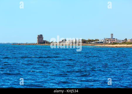 Picturesque Ionian sea Torre Colimena beach,  Salento, Puglia, Italy.  Historical fortification tower Torre Colimena - Stock Photo