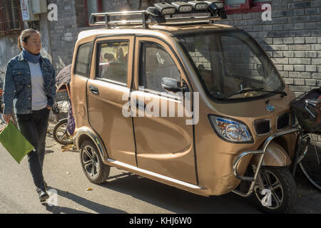 Unlicensed mini electric car is seen in Beijing, China. - Stock Photo