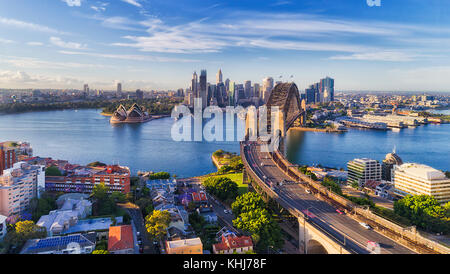 Cahill express way to the Sydney Harbour bridge across Sydney harbour towards city CBD landmarks in aerial eleveated - Stock Photo