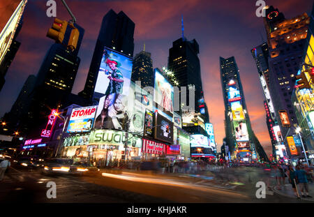 New York, USA, July 10 2011: New York Time Square in the Evening with traffic congestion human crowd and advertising - Stock Photo