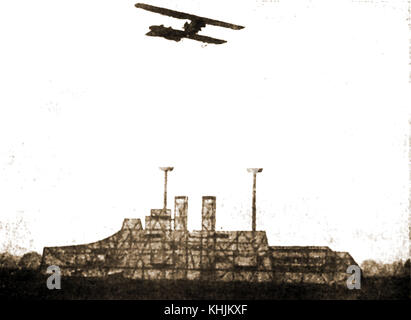 WWI  A German biplane practising bomb dropping on a wooden mock-up of a British Dreadnought battleship (From a German - Stock Photo