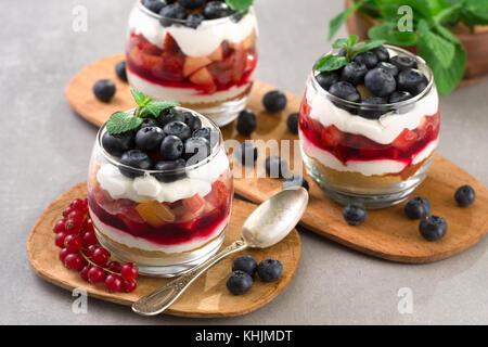blueberry dessert, cheesecake, trifle, parfaits on gray stone background. - Stock Photo
