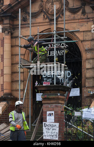 Workmen begin erecting scaffolding to the front of the Grade II listed public Carnegie Library in Herne Hill, closed - Stock Photo