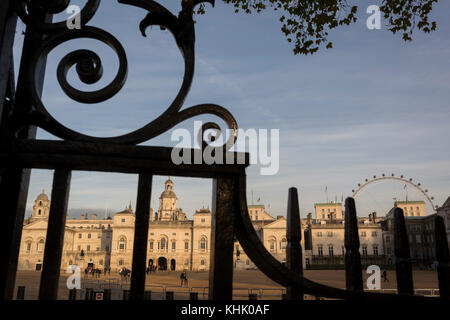 Seen through iron railings is Horseguards in Westminster, on 9th November 2017, London, England. Horse Guards is - Stock Photo