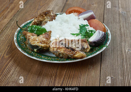 Panta bhat -  rice-based dish in Bangladesh and the eastern Indian states of West Bengal and Assam. with fried Ilish - Stock Photo