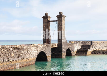 Bridge of the Balls.  Puente de las Bolas leads to San Gabriel Castle in the port city of Arrecife on the Spanish - Stock Photo