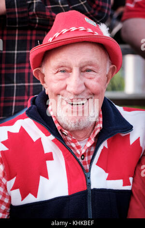 Portrait of male Canadian senior citizen celebrating Canada Day wearing a hat, red and white national colours, smiling - Stock Photo