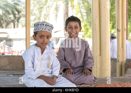 Nizwa, Oman, 10th Nobember 2017: omani kids at a market - Stock Photo