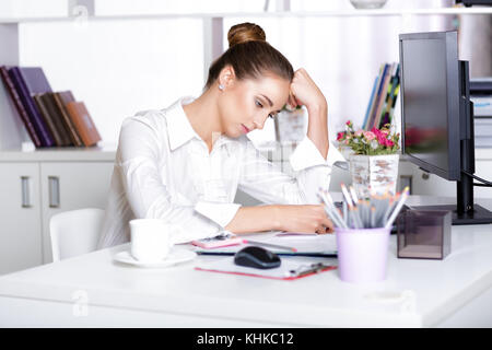 tired woman manager in the office - Stock Photo