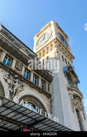 The large clock tower of the Paris 'Gare de Lyon' railway station. - Stock Photo