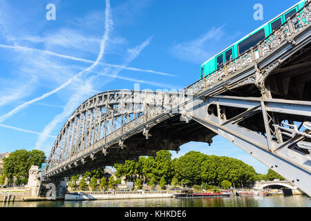 The Austerlitz viaduct in Paris, seen from the right bank of the river Seine with a metro train passing, is a single - Stock Photo