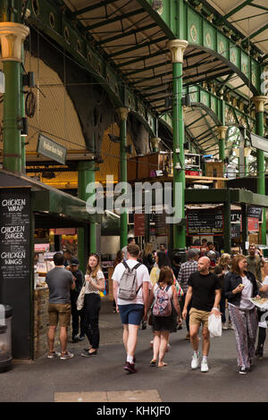 UK, London, Southwark, Borough Market, food stalls and visitors below railway arches - Stock Photo