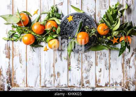 Christmas table decorations with clementines - Stock Photo