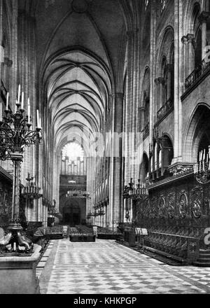 View of the nave at Notre Dame Cathedral in Paris, photograph by Crete, France, July, 1922. - Stock Photo