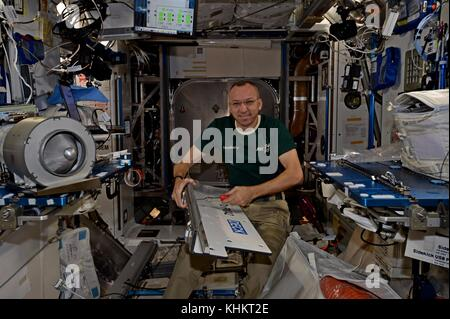 Expedition 53 American astronaut Randy Bresnik works on installing ducting and fan for future commercial crew vehicles - Stock Photo