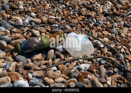 Washed up rubbish on the beach - Stock Photo