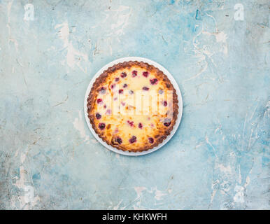 Delicious dessert on a plate, sweet tasty cheesecake with fresh berries. Top view. - Stock Photo