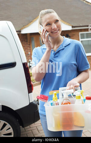 Young Woman Running Mobile Cleaning Business With Van Using Mobile Phone - Stock Photo