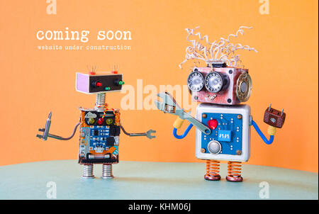Web site under construction Coming Soon template page. Service robots maintenance with adjustable spanner screwdriver. - Stock Photo