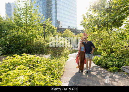 Couple walking together in a park - Stock Photo