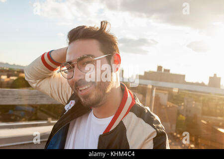 Portrait of a young man on a rooftop - Stock Photo