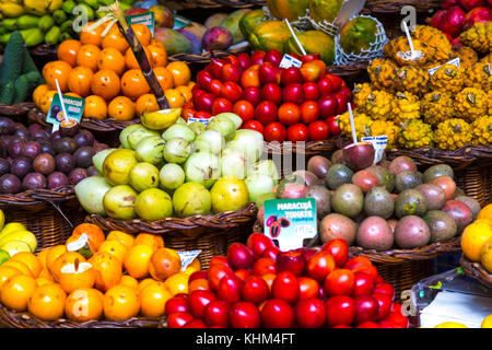 Colourful exotic fruit display at a market stall at Mercado dos Lavradores, Funchal, Madeira - Stock Photo