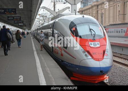 SAINT-PETERSBURG, RUSSIA - JUNE 24: Passengers boarding the train sapsan at the Saint-Petersburg on June 24, 2015. - Stock Photo