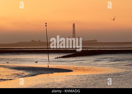 Westerheversand Lighthouse at sunset, Westerhever, Eiderstedt, Schleswig-Holstein, Germany, Europe - Stock Photo