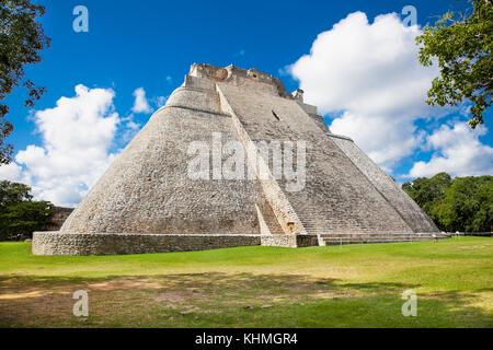 Pyramid of the Magician (Piramide del adivino) in ancient Mayan city Uxmal, Mexico - Stock Photo