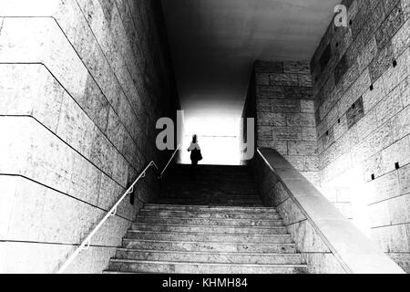 Silhouette at the end of the stairs - Stock Photo