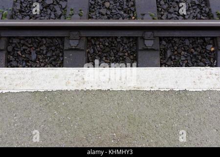 Railway platform white line edge marking, burrs country park railway station in bury lancashire uk - Stock Photo